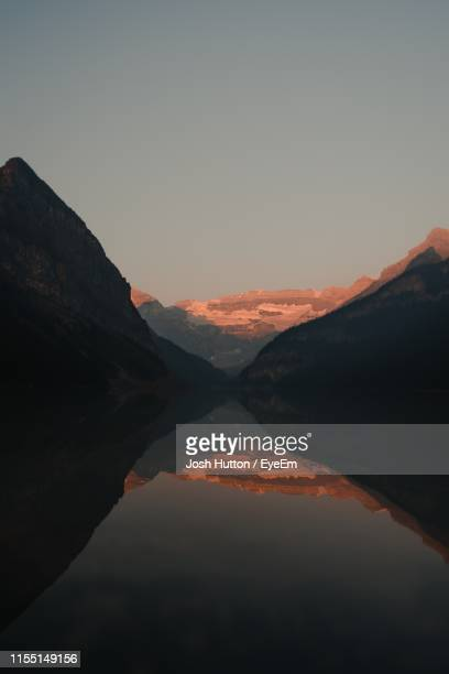 scenic view of lake against sky during sunset - hutton stock photos and pictures