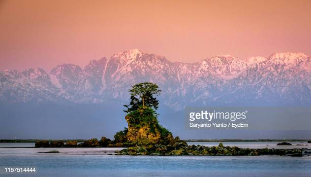 scenic view of lake against sky during sunset - 富山県 ストックフォトと画像
