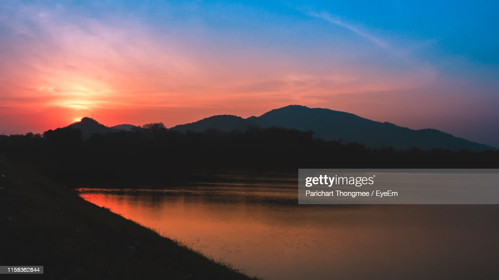 Scenic View Of Lake Against Sky During Sunset : Stock Photo