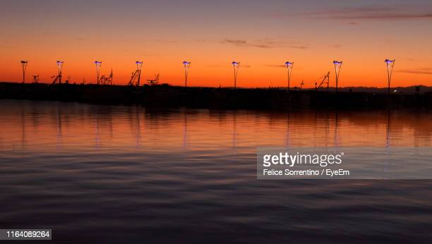 scenic view of lake against sky during sunset - koper stock photos and pictures