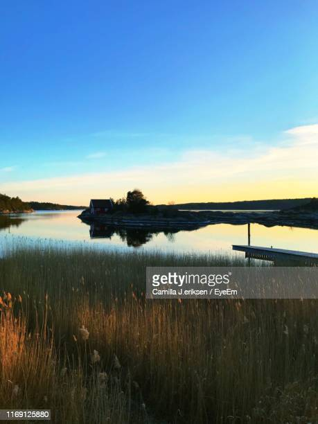 scenic view of lake against sky during sunset - eriksen stock pictures, royalty-free photos & images