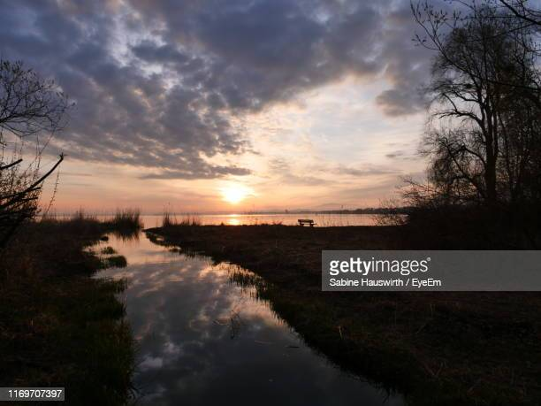 scenic view of lake against sky during sunset - sabine hauswirth stock pictures, royalty-free photos & images
