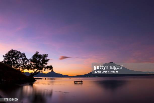 scenic view of lake against sky during sunset - guatemala city stock pictures, royalty-free photos & images