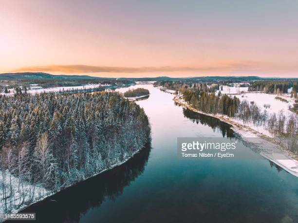 scenic view of lake against sky during sunset - sweden stock pictures, royalty-free photos & images