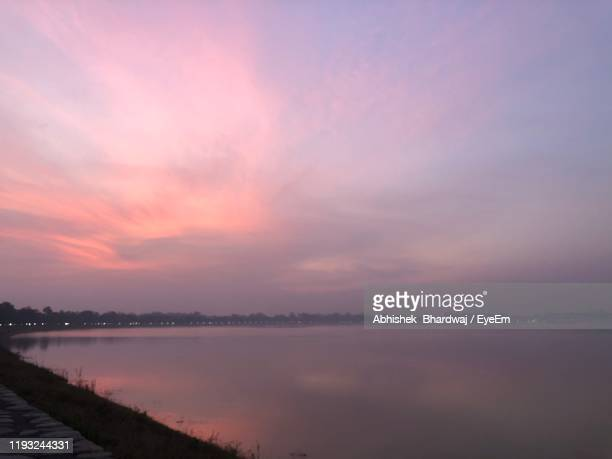 scenic view of lake against sky during sunset - chandigarh stock pictures, royalty-free photos & images