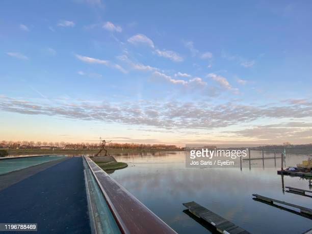 scenic view of lake against sky during sunset - オランダ リンブルフ州 ストックフォトと画像