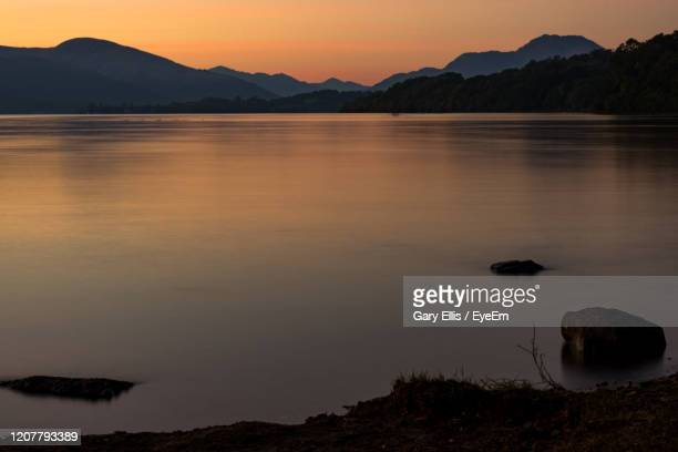 scenic view of lake against sky during sunset - glasgow stock pictures, royalty-free photos & images