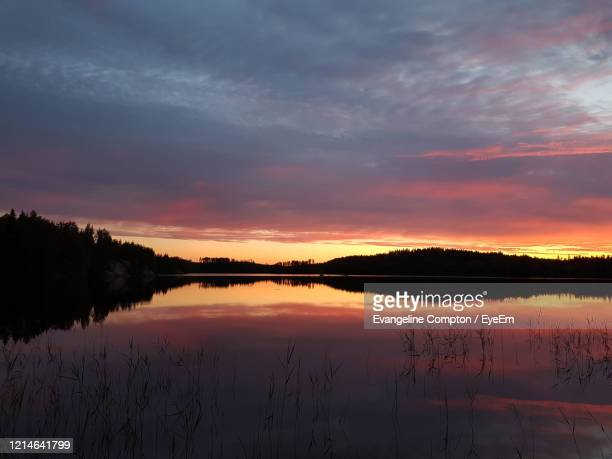 scenic view of lake against sky during sunset - forrest compton stock pictures, royalty-free photos & images