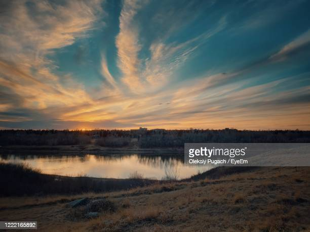 scenic view of lake against sky during sunset - saskatoon stock pictures, royalty-free photos & images