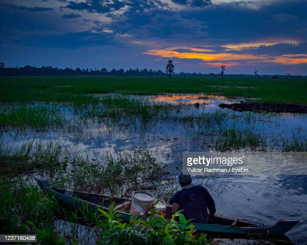 scenic view of lake against sky during sunset - central kalimantan stock pictures, royalty-free photos & images