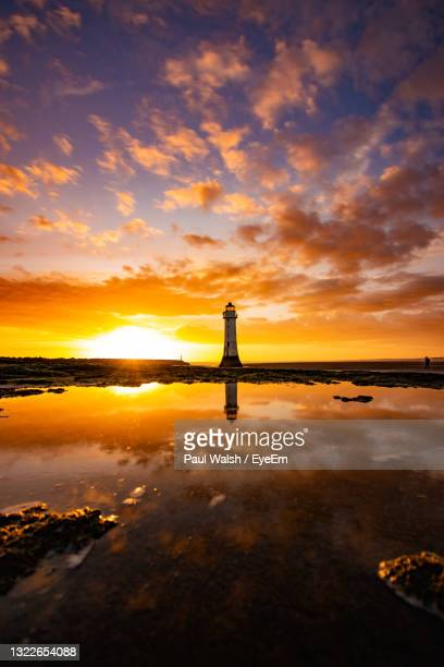 scenic view of lake against sky during sunset - liverpool england stock pictures, royalty-free photos & images