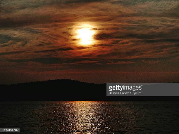 scenic view of lake against sky during sunset - lopez stock pictures, royalty-free photos & images