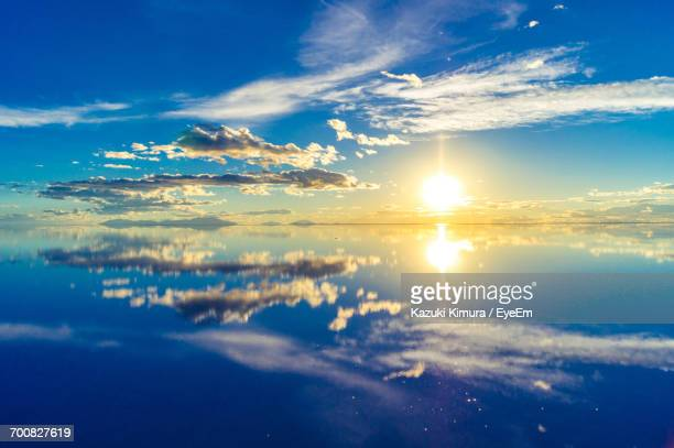 scenic view of lake against sky during sunset - ウユニ ストックフォトと画像