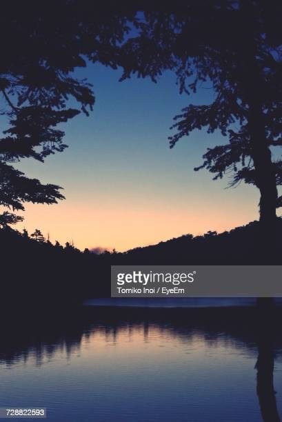 scenic view of lake against sky during sunset - tomiko inoi ストックフォトと画像