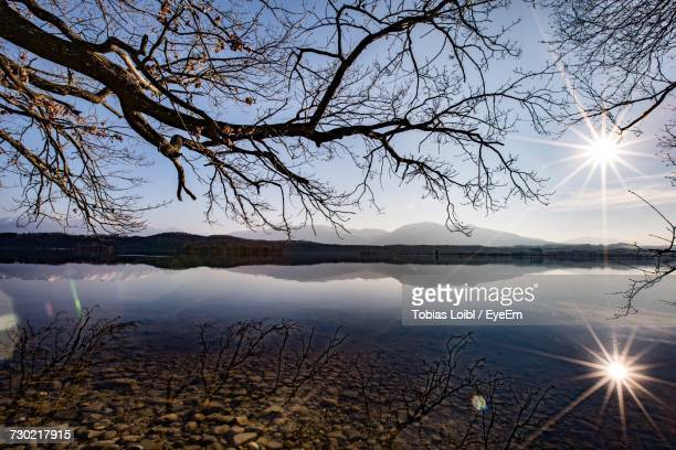 scenic view of lake against sky during sunset - loibl stock-fotos und bilder