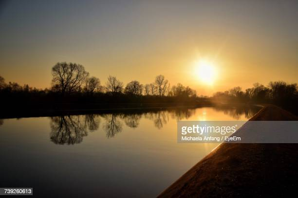scenic view of lake against sky during sunset - anfang stock pictures, royalty-free photos & images