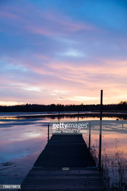 scenic view of lake against sky during sunset - oskar stock pictures, royalty-free photos & images
