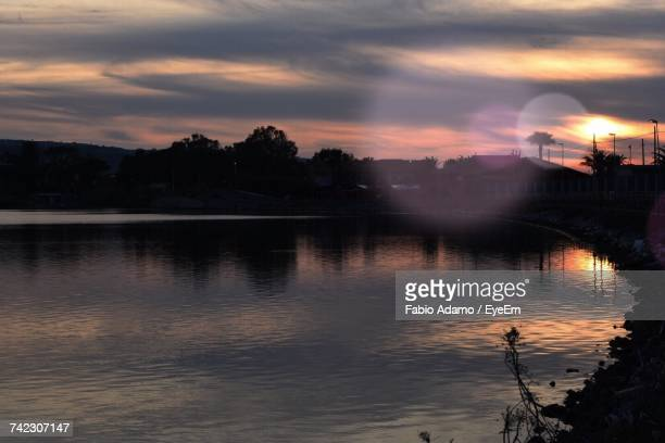 scenic view of lake against sky during sunset - adamo photos et images de collection