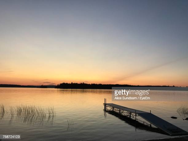 scenic view of lake against sky during sunset - st. albans stock pictures, royalty-free photos & images