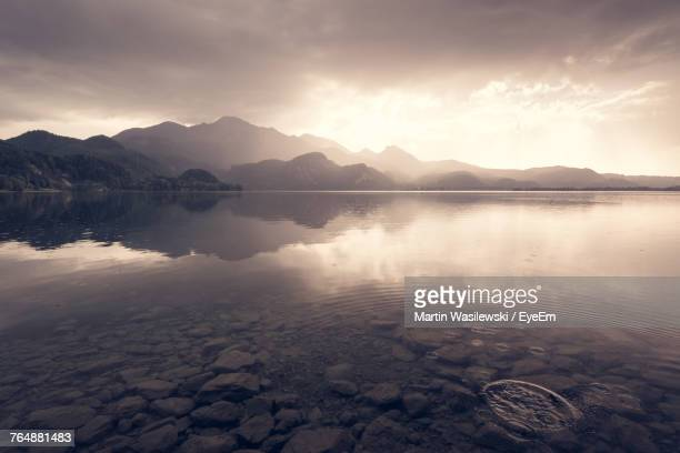 scenic view of lake against sky during sunset - tranquil scene stock pictures, royalty-free photos & images