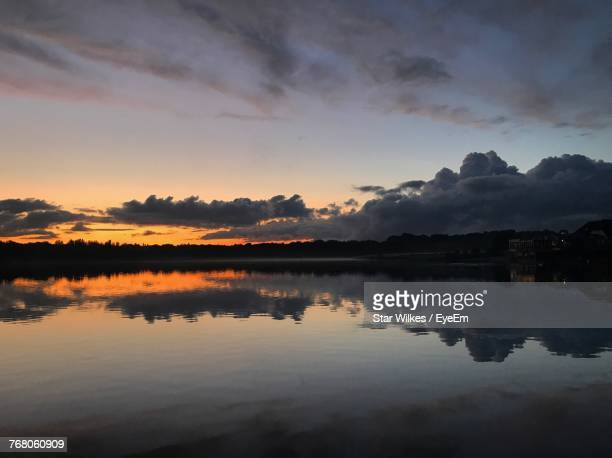 scenic view of lake against sky during sunset - sutton coldfield stock photos and pictures