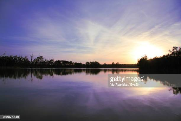 scenic view of lake against sky during sunset - ratnieks stock pictures, royalty-free photos & images