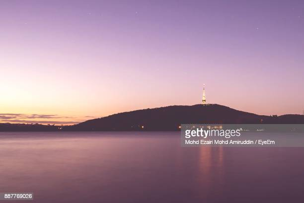 scenic view of lake against sky during sunset - canberra stock pictures, royalty-free photos & images