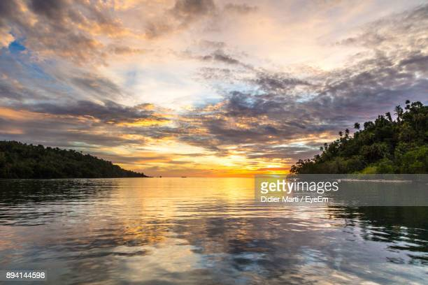 scenic view of lake against sky during sunset - didier marti stock photos and pictures