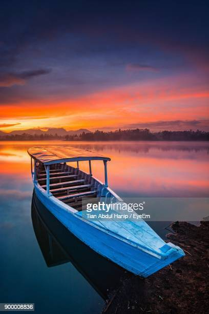scenic view of lake against sky during sunset - tian abdul hanip stock photos and pictures