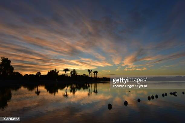 scenic view of lake against sky during sunset - lake havasu stock photos and pictures