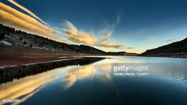 scenic view of lake against sky during sunset - fort collins stock pictures, royalty-free photos & images