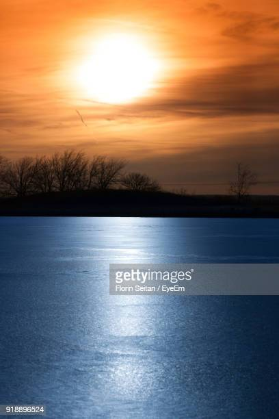 scenic view of lake against sky during sunset - florin seitan stock pictures, royalty-free photos & images