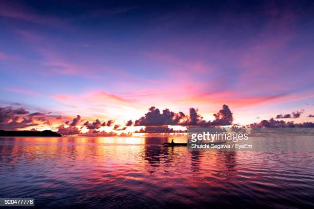 scenic view of lake against sky during sunset - guam stock pictures, royalty-free photos & images