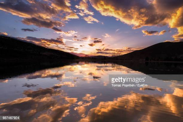 scenic view of lake against sky during sunset - avon colorado stock photos and pictures