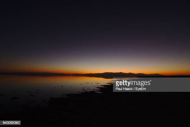 scenic view of lake against sky during sunset - haack stock pictures, royalty-free photos & images