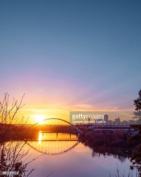 scenic view of lake against sky during sunset - edmonton stock pictures, royalty-free photos & images
