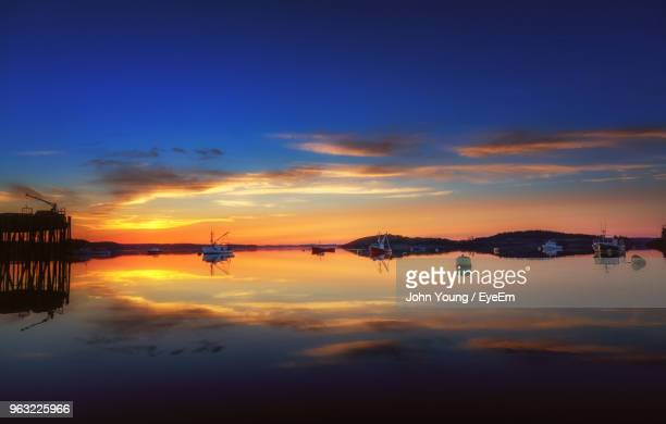 scenic view of lake against sky during sunset - lubec stock photos and pictures
