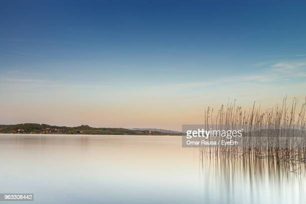 scenic view of lake against sky during sunset - bodensee stock-fotos und bilder
