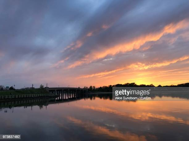 scenic view of lake against sky during sunset - sag harbor stock photos and pictures