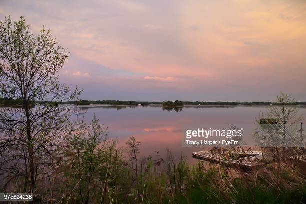 scenic view of lake against sky during sunset - lake of the woods stock pictures, royalty-free photos & images
