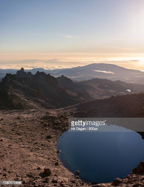 scenic view of lake against sky during sunset,meru county,kenya - meru filme stock-fotos und bilder