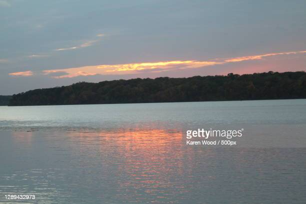 scenic view of lake against sky during sunset,solomons,maryland,united states,usa - 2010 stock pictures, royalty-free photos & images