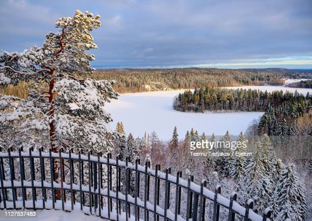 scenic view of lake against sky during winter - teemu tretjakov stock pictures, royalty-free photos & images