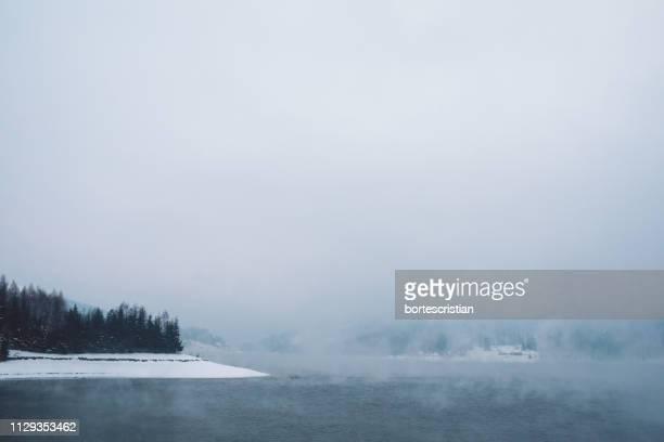 scenic view of lake against sky during winter - bortes foto e immagini stock
