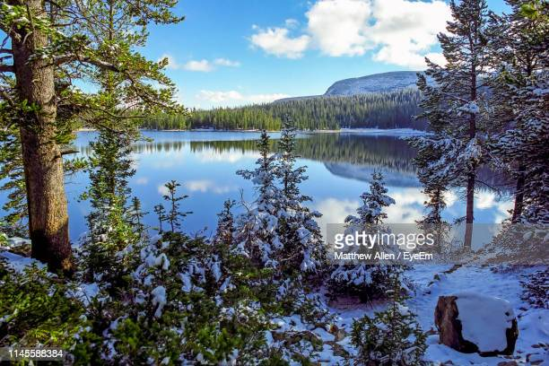 scenic view of lake against sky during winter - mirror lake stock pictures, royalty-free photos & images
