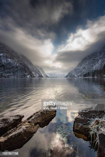 scenic view of lake against sky during winter - andy dauer stock pictures, royalty-free photos & images