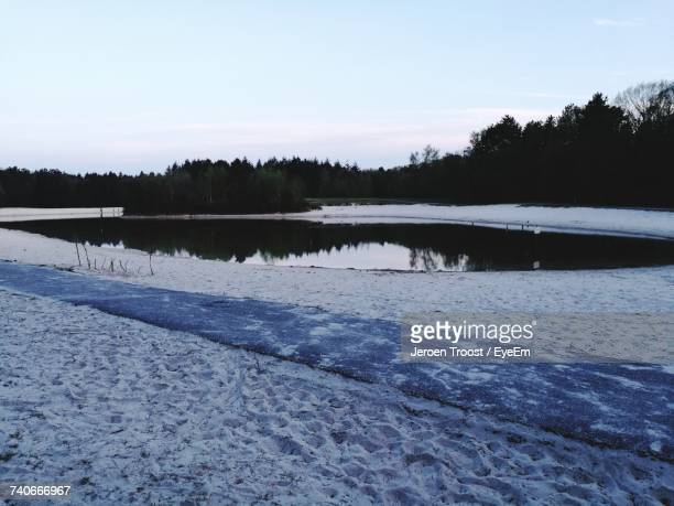 scenic view of lake against sky during winter - hoogeveen stock pictures, royalty-free photos & images