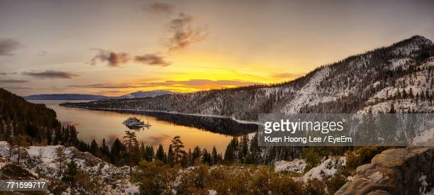 scenic view of lake against sky during winter - lake tahoe stock photos and pictures