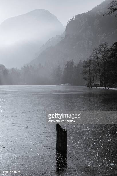 scenic view of lake against sky during winter,bad reichenhall,germany - andy dauer stock pictures, royalty-free photos & images