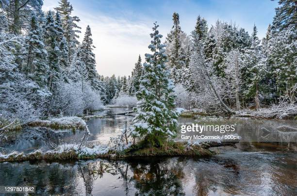 scenic view of lake against sky during winter,grand marais,michigan,united states,usa - minnesota stock pictures, royalty-free photos & images